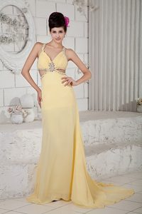 Exquisite Light Yellow Beaded Pageant Dress with Brush Train and Crisscross